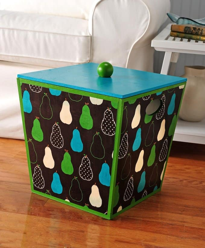I wanted a unique storage solution for my yarn, so I made this fabric covered box with a fun pear print and Mod Podge! It's easy to do.