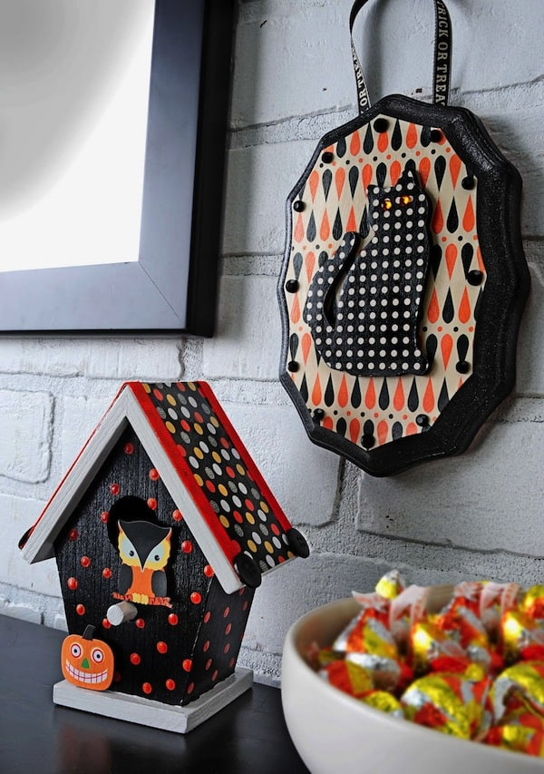 Make these mini Halloween decorations using $1 plaque and $1 birdhouses from the craft store. Very easy, colorful, and fun!