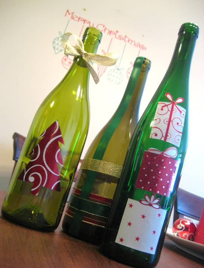 Decoupage wine bottle christmas craft mod podge rocks for Christmas bottle decorations