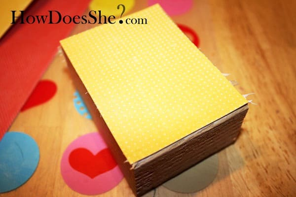 Leave sweet messages for your family with this love note Valentine's Day decor, built with scrap wood and decorated with pretty papers and Mod Podge.