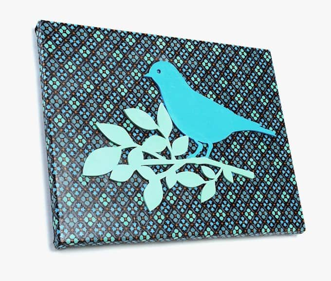 This fabric canvas art uses fun, patterned fabric for the background. Just add a painted wood cut out to the front for instant wall decor.