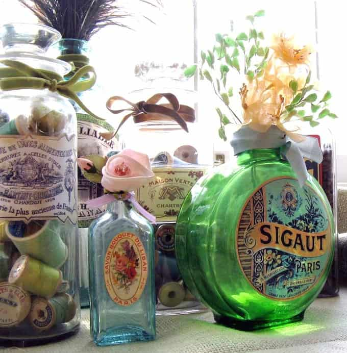Decorate bottles with vintage labels mod podge rocks - How to decorate old bottles ...