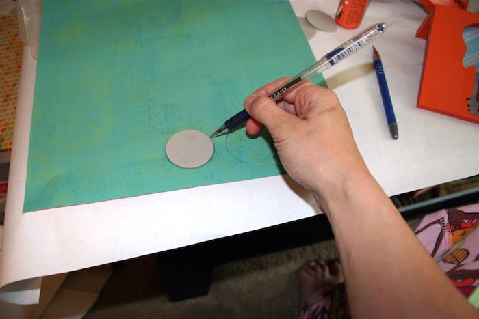 Trace chipboard circles on scrapbook paper