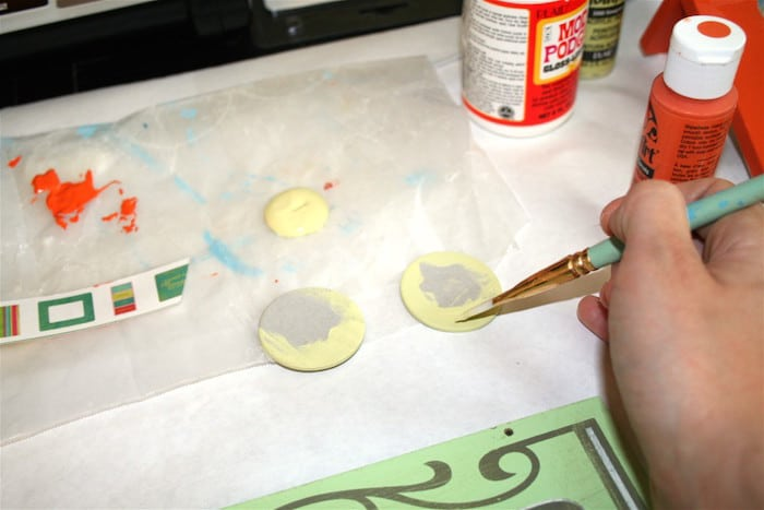 Paint chipboard circles with lime paint