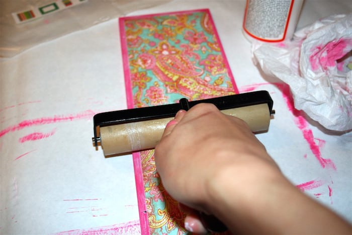 Roll the paper down with a brayer