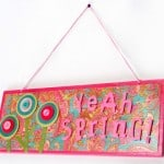 Make this fun spring craft: a Mod Podge sign using dollar store materials! Pick your favorite colors and scrapbook papers to personalize.