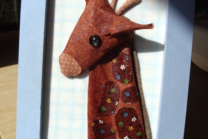 Fabric giraffe art with Mod Podge