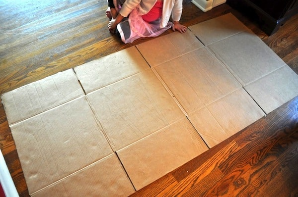 Cardboard box spread out on the floor