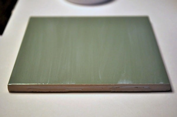 A thin coat of Mod Podge painted on a tile