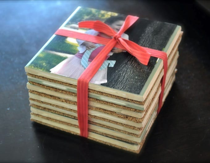 DIY photo coasters stacked and tied with a ribbon