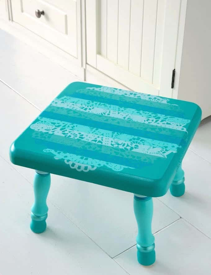 Paint a wooden stool using a paper doily as a resist instead of a stencil! Incorporate your favorite paint colors, then seal with Mod Podge.