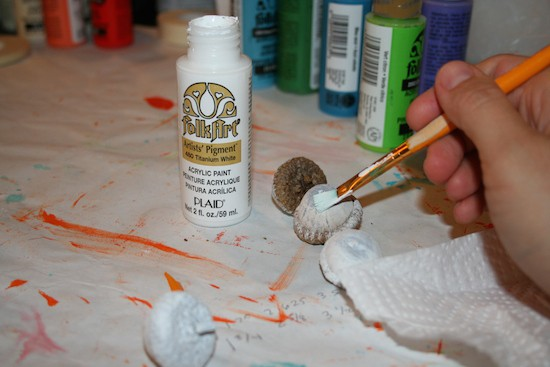 Painting acorns with white craft paint