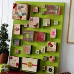 DIY advent calendar using a canvas and boxes for the gifts!