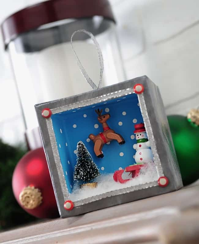 Use Mod Podge Silver Shimmer, holiday minis and a paper mache box to create a unique Christmas shadowbox ornament. This was so fun to make!