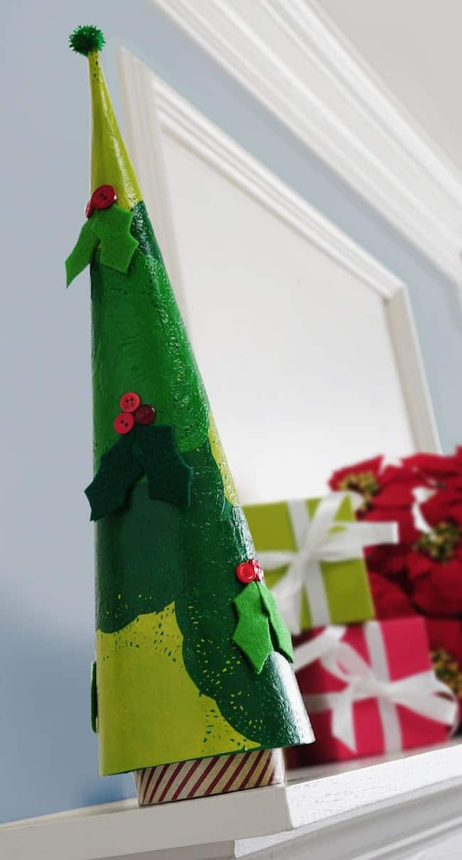 Decorate a paper mache tree for the holiday season! This Christmas tree was made with doilies, paint, and Mod Podge. It's REALLY easy! This decoupage project can be customized for rustic, vintage, or farmhouse Christmas decor.