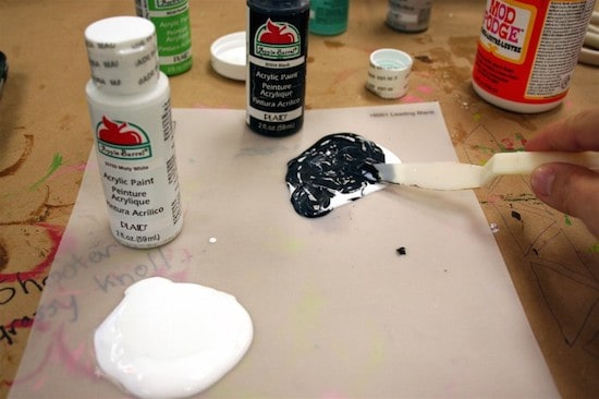 Mixing black acrylic paint and Mod Podge