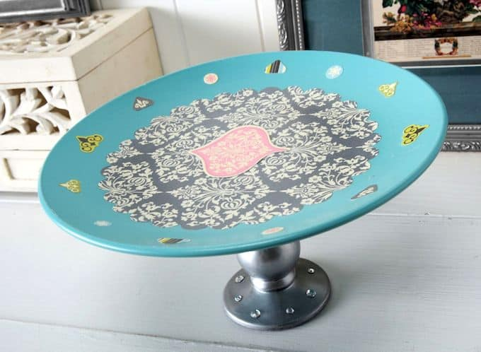 Diy cake stand with dollar store supplies mod podge rocks for Plate cake stand diy
