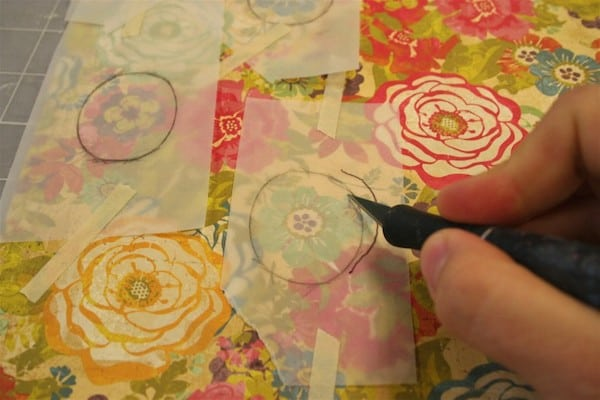 Cut out scrapbook paper with a craft knife