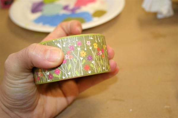 Wrap paper around a wood bracelet and glue with Mod Podge