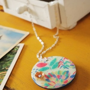 For this unique necklace DIY you'll use a wood pendant, Dimensional Magic, and the image of your choice. Great for gifts and easy to personalize!