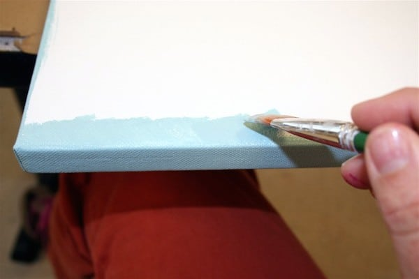 Paint the edges of a square canvas with blue acrylic paint
