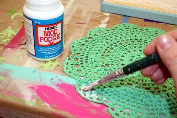 Add Fabric Mod Podge to a round green doily from Michaels