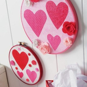 These valentine decorations are SO easy! Use fabric and Mod Podge to create wall art with embroidery hoops. Hang anywhere you like.
