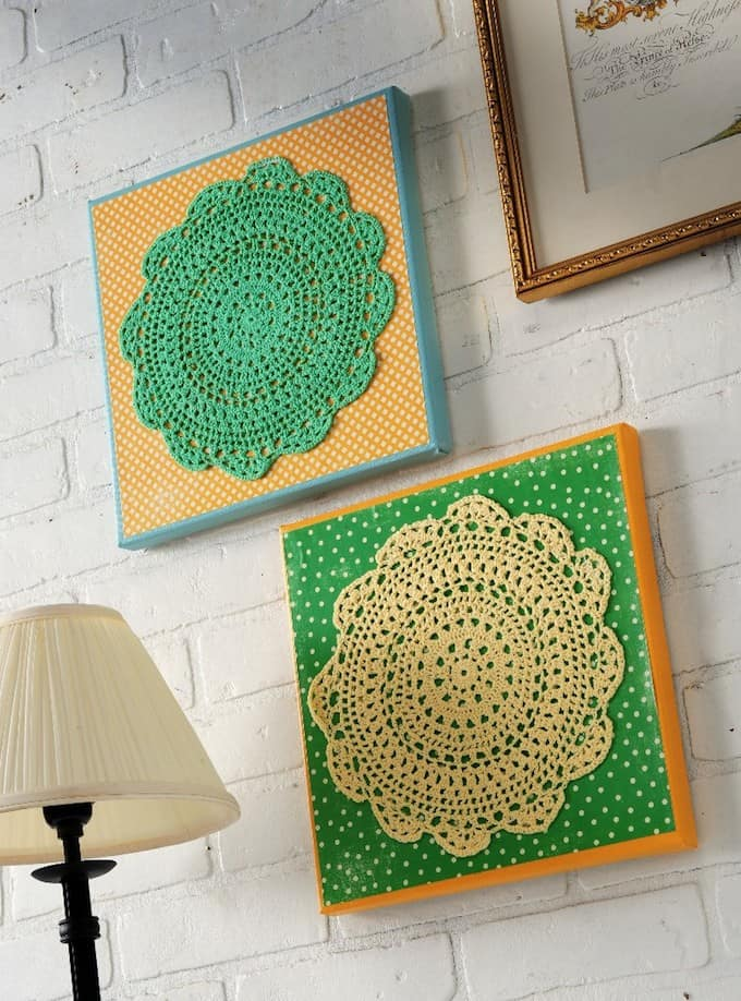 Doilies aren't just for sitting on the table under a teacup - turn them into doily wall art using Mod Podge, scrapbook paper and canvases.