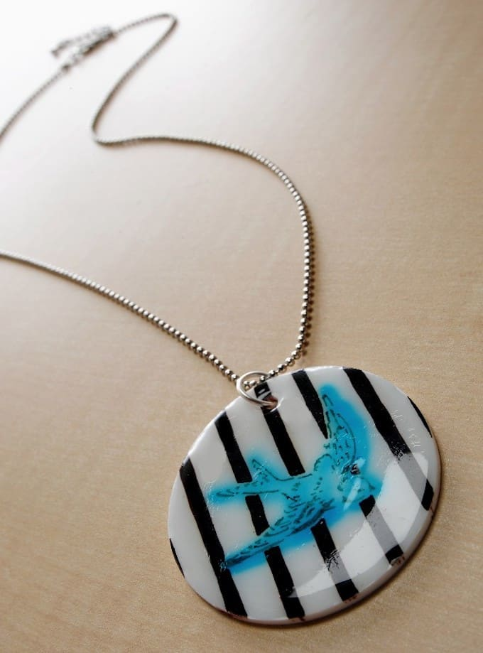 This DIY Shrinky Dink necklace was so easy! If you love Shrinky Dink jewelry, this is a fun project to try. Use Sharpies and a stencil to get the look!