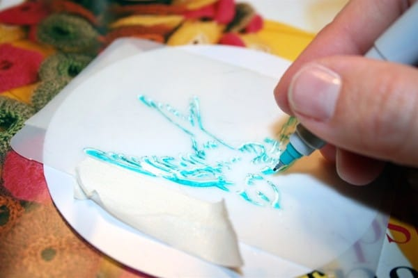 Coloring in a stencil using a Sharpie on a Shrinky Dink