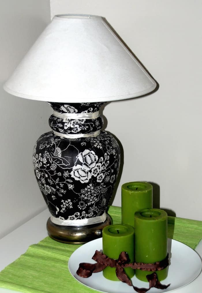 This DIY lamp was created by adding fabric to an old base using Mod Podge. You can recreate with any fabric you like - this easy tutorial shows you how.