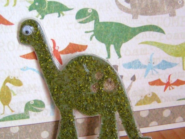 Mod Podge dinosaur pin with glitter