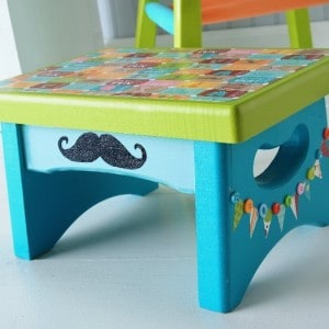 If you're looking for circus themed crafts, this decoupage stool fits the bill. I added pennants and then glitter to really make it special.
