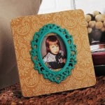 Create a decoupage frame masterpiece by adding a damask accent to a wood frame found at the craft store for $1. Use your favorite paper and Mod Podge.