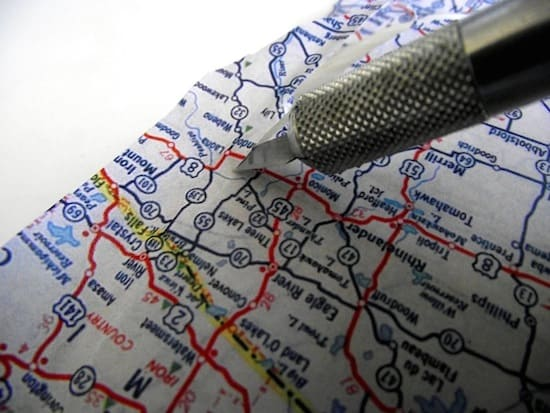 Cutting the edge of a map with a craft knife