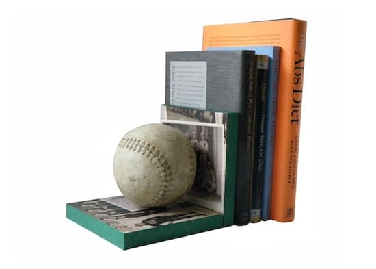 Looking for an original idea for the sports fan in your life? Make bookends! These baseball bookends use scrap wood and Mod Podge to personalize.