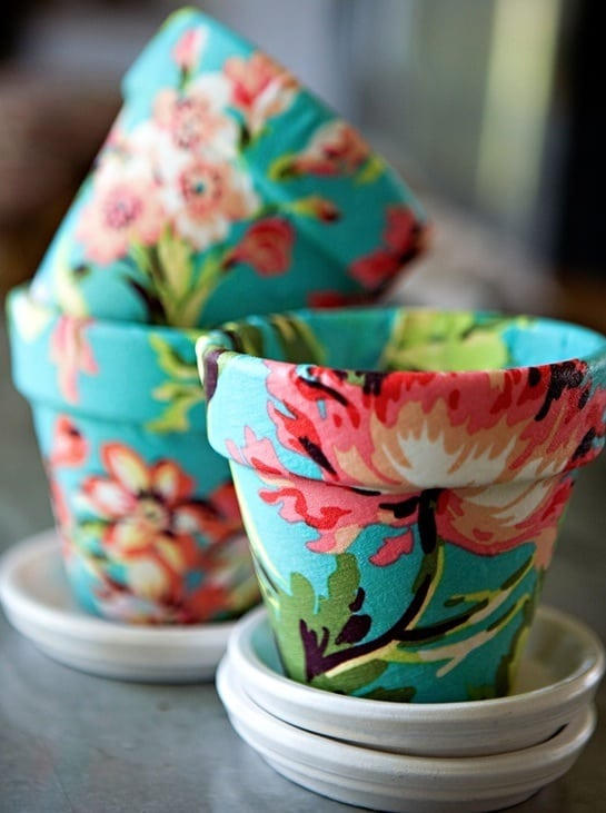 Decoupage fabric on terra cotta in this fun diy flower pot project youll