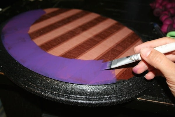 Paint the Halloween wall decor with purple paint