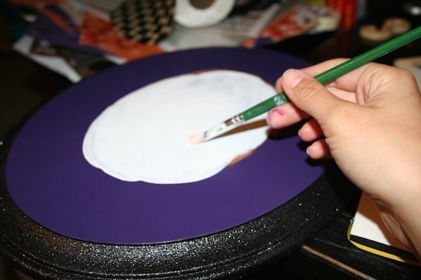 Paint the center of your Halloween wall decor with white craft paint