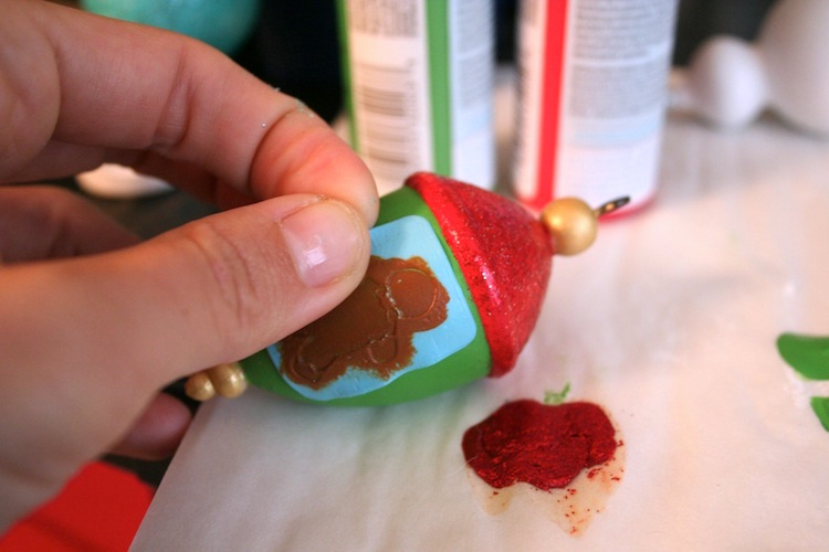 Applying paint to a Christmas ornament