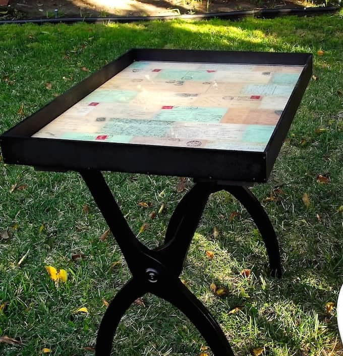 If you are into salvaged furniture, this DIY end table is perfect for you! It was made using an old luggage rack and cabinet door.