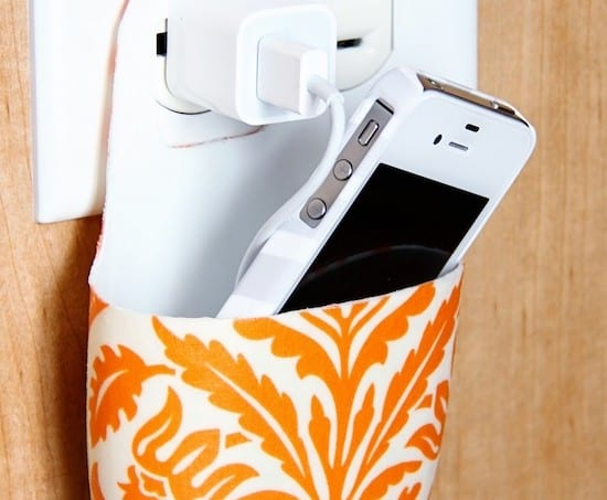 Not sure where to put your phone while it's charging? Make a cell phone holder from a lotion bottle using Mod Podge, and keep it near the plug.