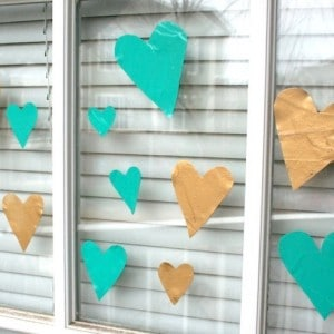 This valentine's craft for kids is so easy - all you need is colorful acrylic paint and Mod Podge to make these fun heart glass clings.