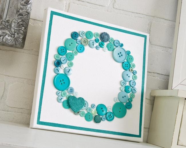 Make a unique canvas with a button wreath