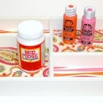 I'm a huge fan of DIY organization - especially when it's pretty! Make this decoupage tray with Mod Podge and scrapbook papers.