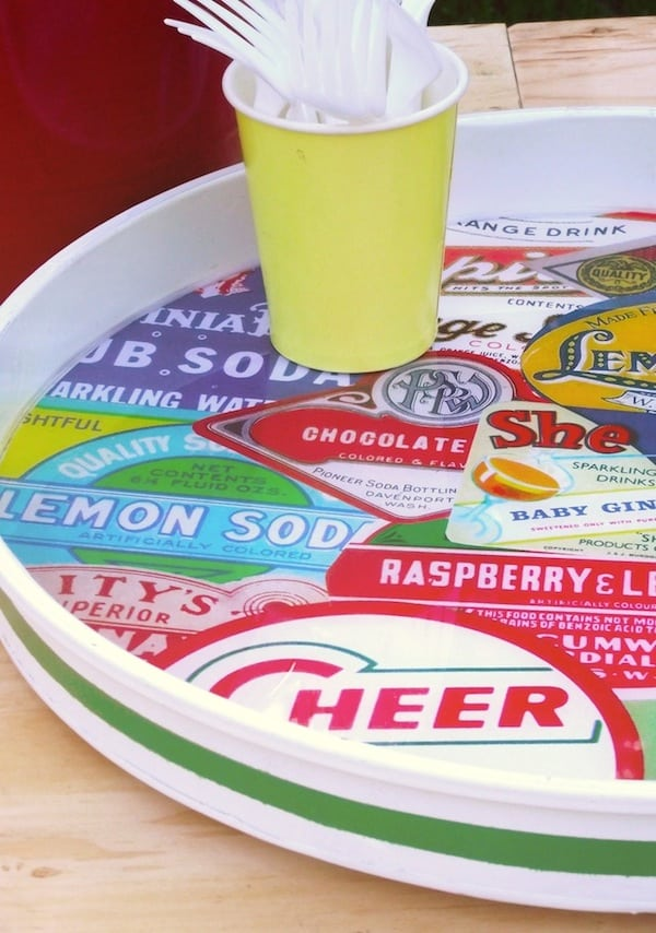 This DIY lazy susan is so cool - it was created from a planter saucer! Head to the hardware store and collect some vintage images for this fun craft.