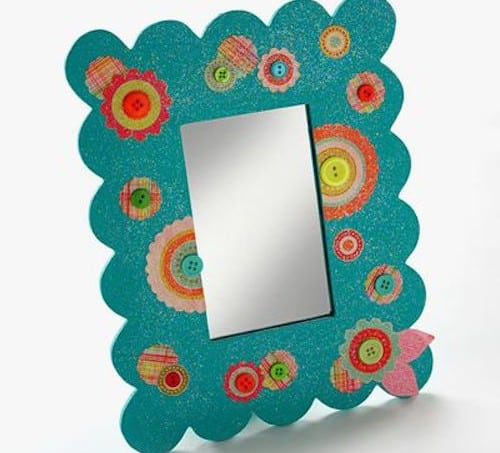 If you are looking for a really fun dollar store craft, this DIY diva mirror is just the ticket. I revamped it with pretty paper, paint and Mod Podge.