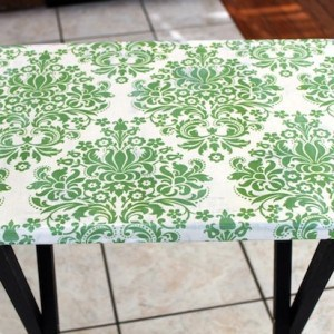 Don't throw out that used TV tray - turn it into a DIY craft table using fabric and Mod Podge! Just cover the top with your favorite pattern: so easy!