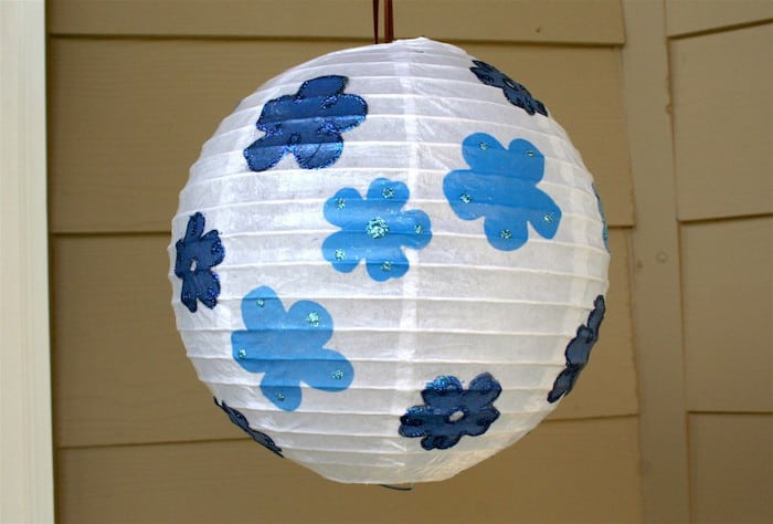 This is yet another great way to DIY your next celebration - decorate a party lantern lantern with glitter and Mod Podge. So easy!