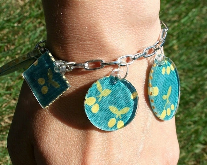 Are you looking for a fun jewelry craft or a unique gift idea? This DIY charm bracelet is made with cute fabric and Dimensional Magic!